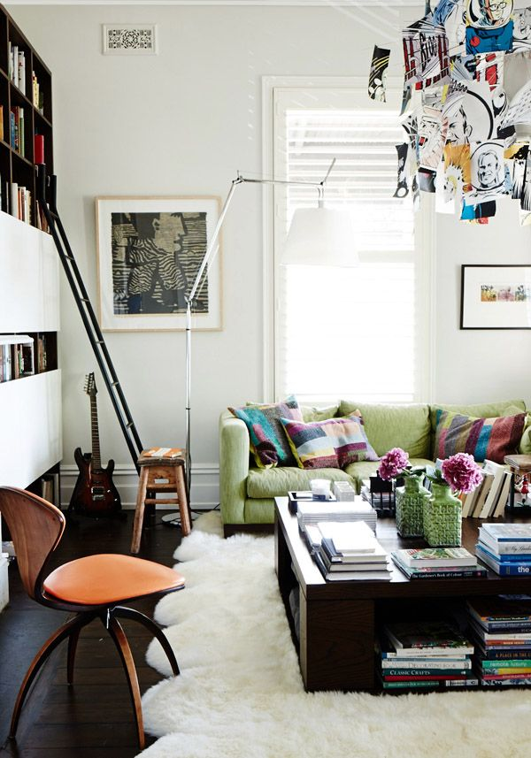We love the cozy, well-read feel the ladder brings to this Australian living room.