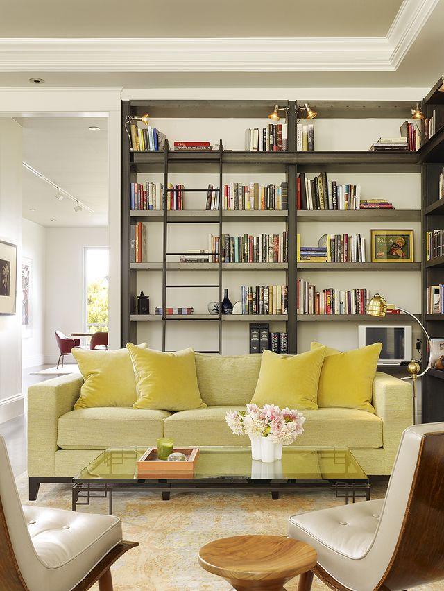 A steel ladder lends an industrial-modern look to this living room.