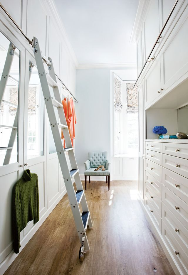 All of a sudden a small closet feelshuge when you can swiftlyreach things up high. We like the glamorous look of the brass ladder bar here, too.
