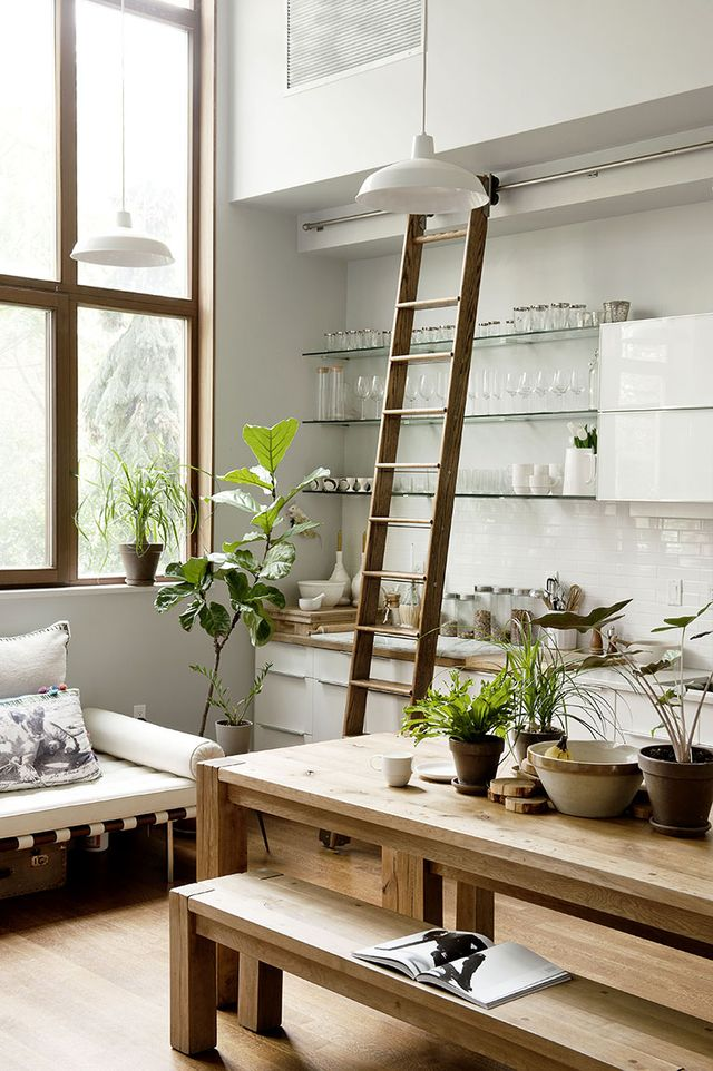 One homeowner made use of this kitchen's tall ceilings and a sliding library ladder to make reaching everyday glassware much easier.