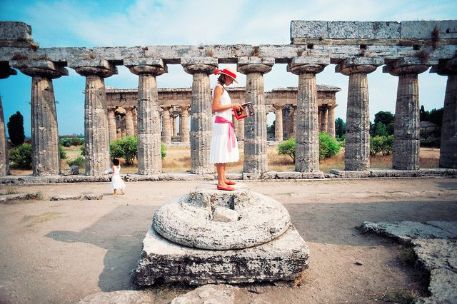 A young girl pauses in front of the Temple of Poseidon at Paestum, in the Campania region of Italy.