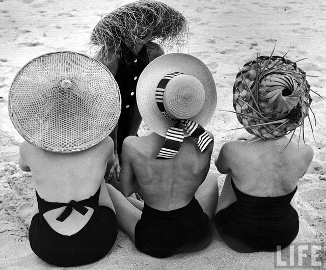 Our takeaway from this classic Nina Leen snap? A black one-piece bathing suit and straw hat are always a good idea.