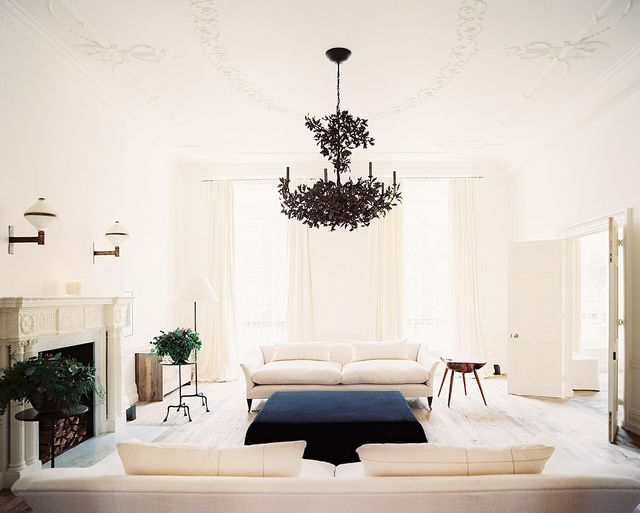Hello, cream dream! This stunning living space makes its centerpiece a breathtaking two-tiered tole chandelier. We very much approve.