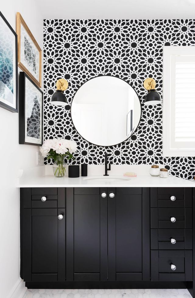 """My daughter and I were both drawn to bathrooms with a black-and-white color scheme, so I knew I had to paint her vanity black and add white in the form of the marble hexagon floor tiles and..."
