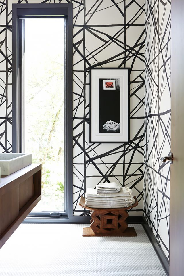 It can be tricky to style small spaces, let alone a tiny restroom. We love how Benjamin Vandiver has transformed this modest bathroom using Kelly Wearstler's dynamic wallpaper. The...
