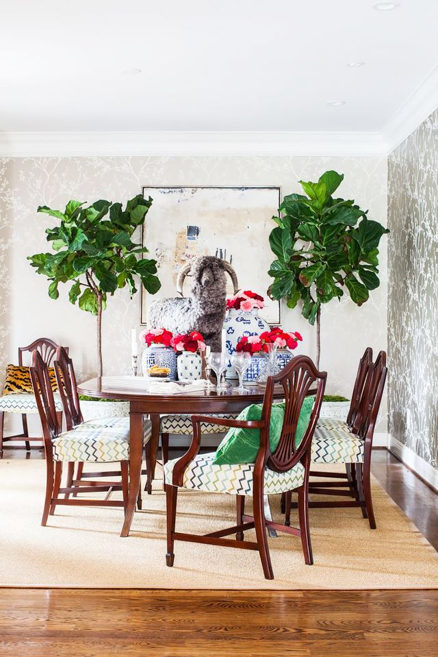 It's not obvious at first glance, but this space actually features quite a bit of pattern, including wallpaper, dining chairs with patterned seat covers, blue porcelain vases, and a...