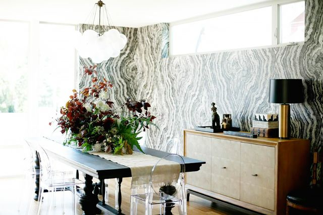 If you're not into throw pillows, choose a standout wallpaper or, in this case, a marble wall feature. What a great conversation piece at the dinner table.
