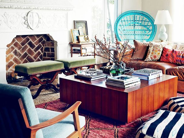 Print can add texture and an eclectic touch to a layered room. The rug and throw cushions in this space break up the heavy furniture with a touch of whimsy. Take the tour of this patterned...