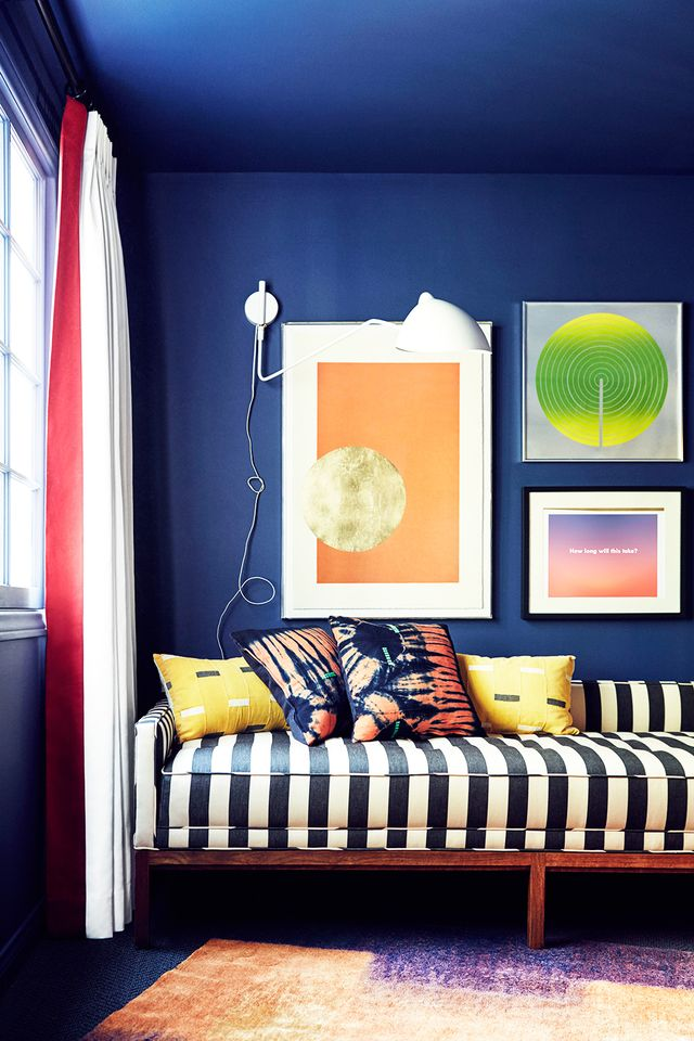 If you're feeling bold and want to step it up a notch, go beyond the casual throw pillow and invest in a patterned piece of furniture. We love this classic navy striped sofa with patterned pillows...
