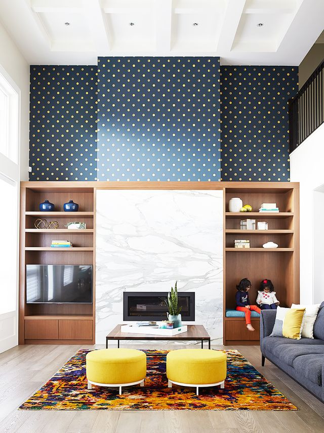 Pattern is the perfect compliment to a large room with high ceilings. The open space can handle bold print, and it will add a touch of coziness to a cold room.
