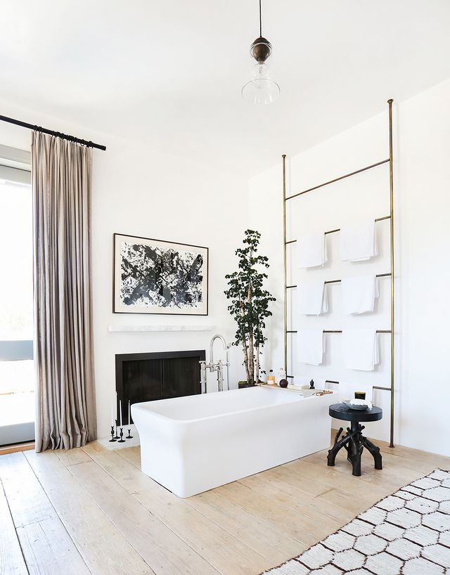 "The biggest challenge of remodeling the 7,000-square-foot, five-bedroom, six-bath home was ""making it feel authentic to the environment—and not like it was McMansion-y,"" she..."