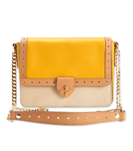 Leave your slouchy bags at home, and opt for a smart structured purse instead.