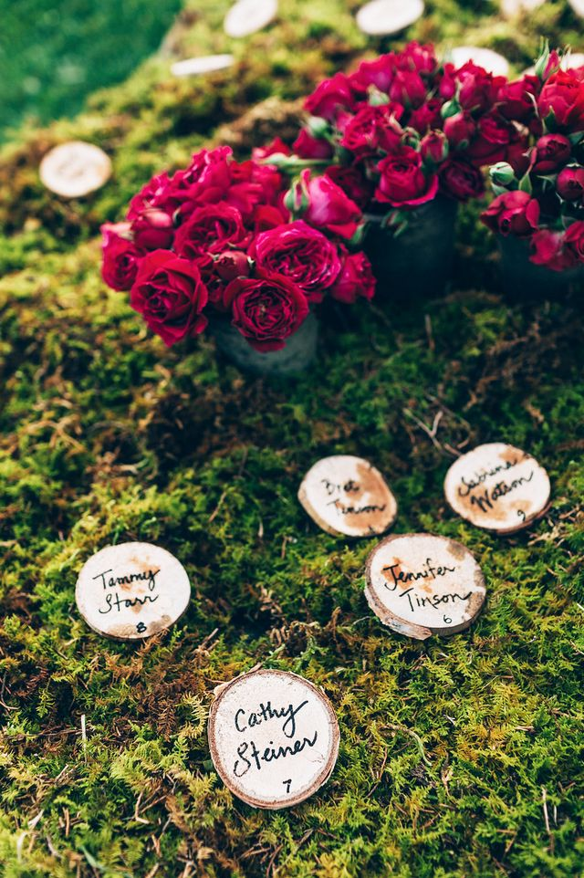 The nuptials were located on an emerald green field by a picturesque pond, and the reception followed nearby under a white, fairy-light-lit tent. Hundreds of red baby garden roses by Frank Rea of...