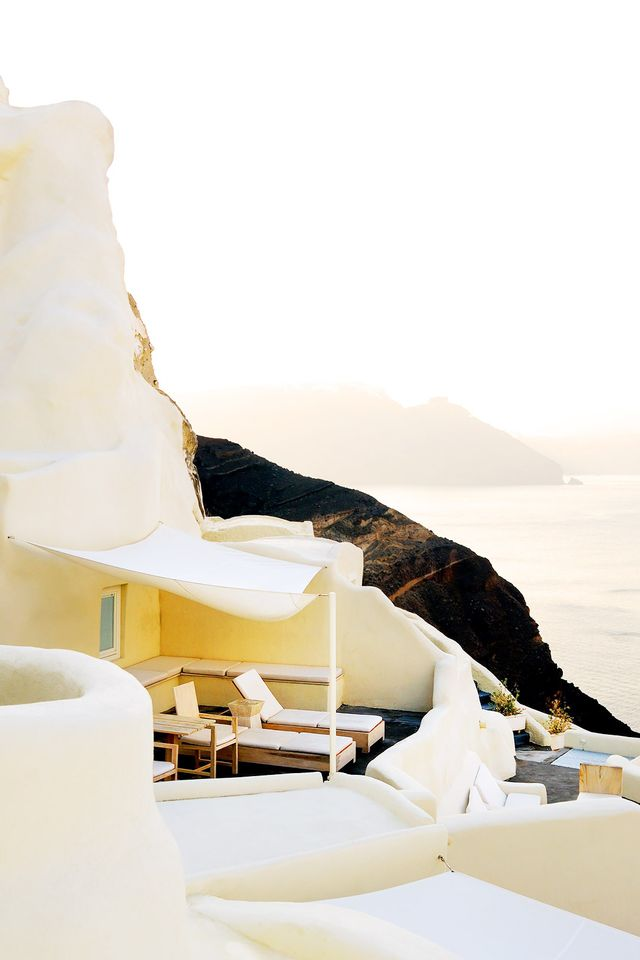 Overlooking the Aegean Sea, this cliff-top hotel shimmers in the late-evening wash of golden sunlight.