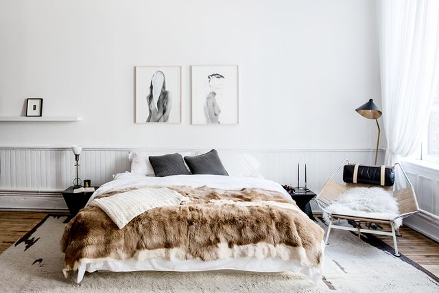 If you feel like your all-white bedroom is a little cold, add some warmth with soft brown and beige tones. A fur throw and a textured rug will add the finishing touch.