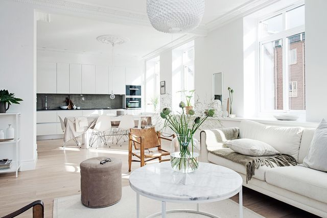Thisspacious open-planroom is perfectly accented with warm tantones and a touch of greenery to break up the white. Different variations of white color have been used...