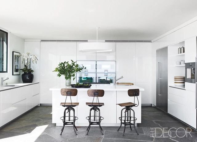 Nothing screams fresh like a completelywhitekitchen. The gorgeous slate floor anchors this pale pretty, and the vintage industrialbar stools bring a touch of the old in with the...