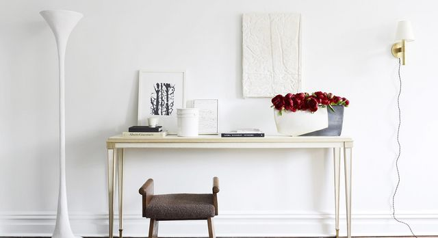 Nothing breaks up a blank canvas like the crimson color of fresh roses. But for a more permanent option, we love the gold wall sconce and textured wall art in the same hue. This adds depth and...