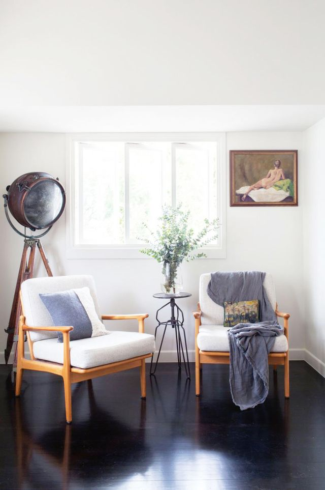 If you really can't handle all-white floor-to-wall spaces, opt for black flooring to bring it down. We love the industrial tripod floor lamp for visual interest in the corner.