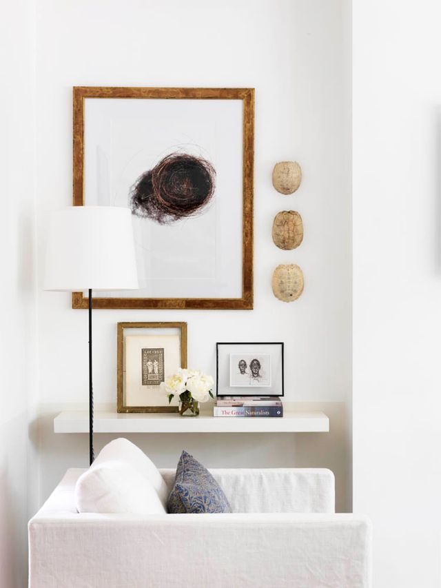An easy white chair in the corner surrounded by sentimental pieces just makes you want to lounge here all afternoon with a good book. The subtle warmth of the wooden frames are complimented with...