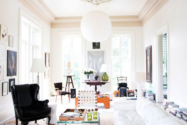 This is a room we all want to dwell in. The eclectic elements against the white add a touch of drama with books liningthe walls, a mix ofchair styles, and a modern pendant lamp. This...