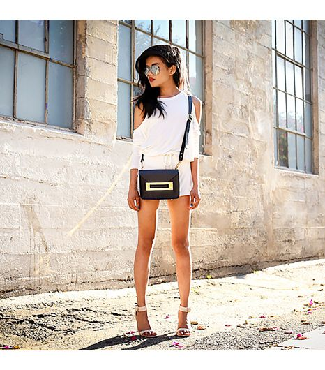 Lusttforlife is wearing: Lust For Life x Blaque Market romper, Sophie Hulme bag.  Get The Look: Zara Ankle Wrap Sandals ($80)  See more ways to wear strappy sandalson Pose.com.