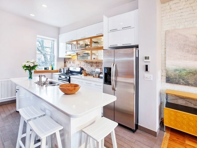 The garden level has a full-floor apartment that can be used as a rental or a family room, office and guest room.
