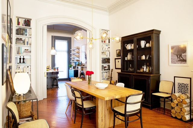 """Characters Jules and Matt's home in Park Slope, Brooklyn, is predominantly charcoal gray, such as their very dark kitchen, with other neutrals and whites. Hathaway explains, """"All of..."""