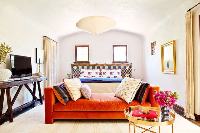 "When it comes to pillows and other textiles, Merrill advises, ""Don't be afraid to mix styles."" She also champions the classic: ""I love a pile of vintage kilim pillows..."