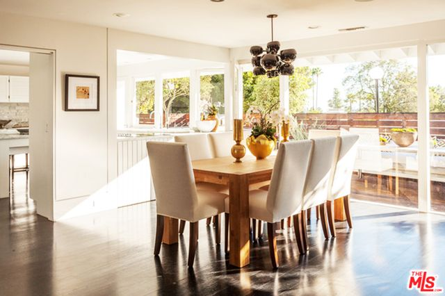 Natural light streams through the home thanks to sliding glass doors, while a gorgeous gourmet kitchen is ideal for any aspiring chef. Rich oak flooring and stylish living and dining rooms give...