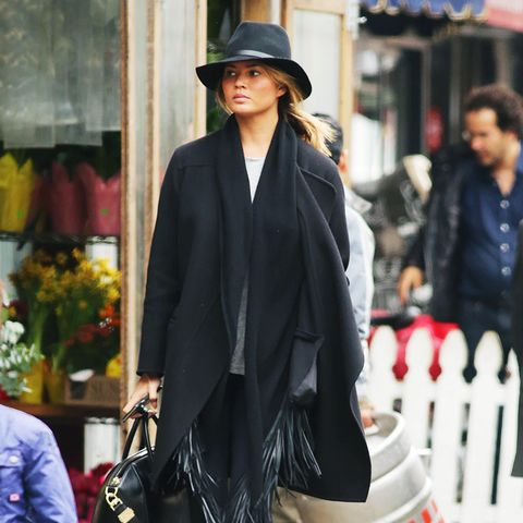 Black coat + scarf + leggings + boots + fedora