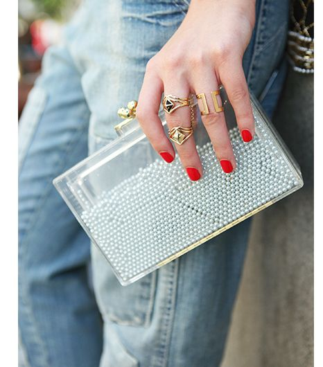 Little pearls cascade around the outer shell of this clear acrylic clutch, making it the ultimate statement accessory.