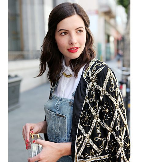 The embellished trophy jacket is obviously the centerpiece of the outfit, but subtle details like a jeweled necklace and red lips and nails underscore the dressy vibe. 