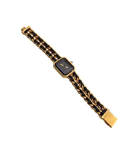 Vintage Wristwatch ($1950) in Black and Gold