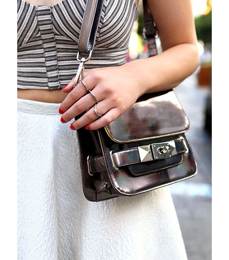 Edgy accessories like a studded metallic bag and linked ring set underscore the faintly downtown feel of the look.