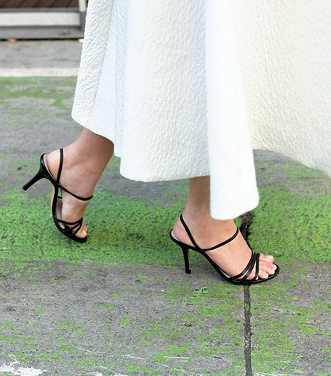 Unless you have model-like height, the midi skirt requires very specific footwear. First, you absolutely must wear a heeled shoe—no exceptions, no excuses. This may sound draconian, but...