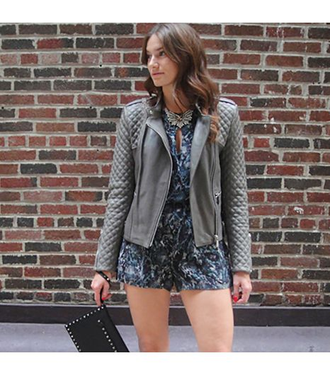 Intermix is wearing: Valentino clutch, Intermix romper, Barbara Bui leather jacket.