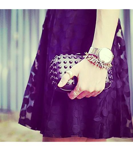Loefflerrandall is wearing: Loeffler Randall bag.
