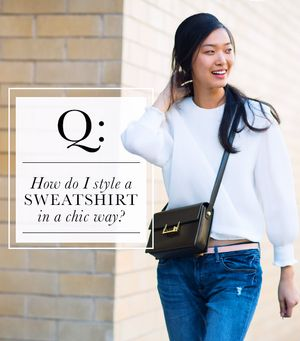How do I style a sweatshirt in a chic way?