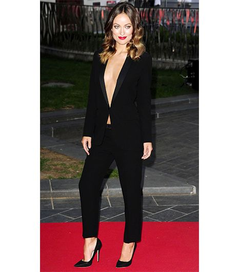 Olivia Wilde  Boxy or oversized silhouettes will overwhelm a slim figure, so a fitted suit like Wilde's is key. While we're not suggesting you go shirtless, there's no denying...