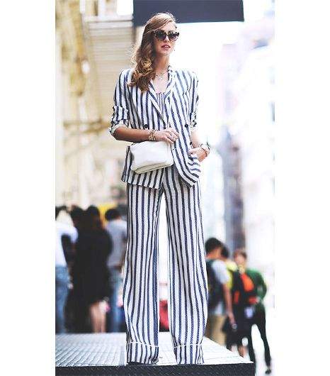 Chiara Ferragni of The Blonde Salad  There's nothing quite like a vertical stripe to lengthen your frame, and in a head-to-toe suit like the blogger's Tommy Hilfiger ensemble, the...