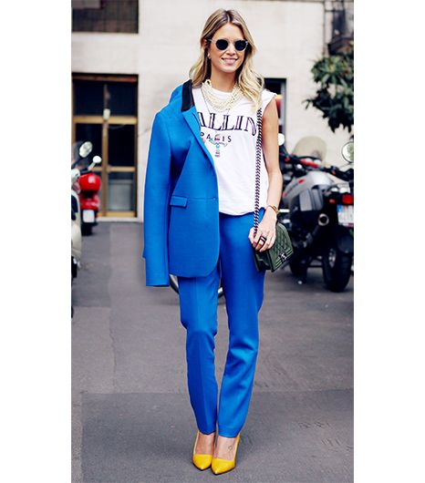 Helena Bordon  A bright blue suit is bound to turn heads, perhaps explaining why the Brazilian blogger chose the snap-happy suit to wear with a graphic Brian Lichtenberg t-shirt, Chanel bag, and...