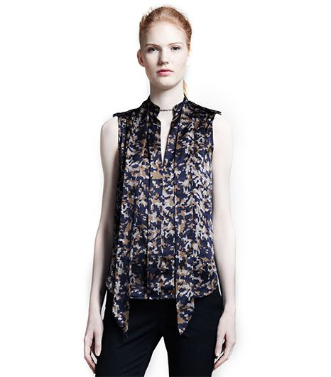 Perfect under a navy suit or tucked into a pencil skirt. 