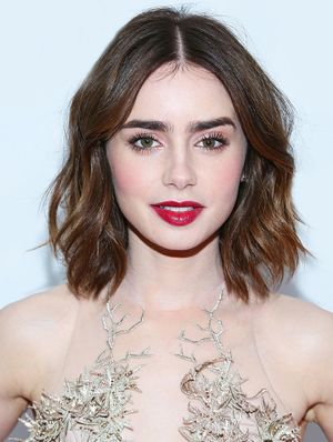 Lily Collins Kicks Off the Holiday Season With A Berry Good Look