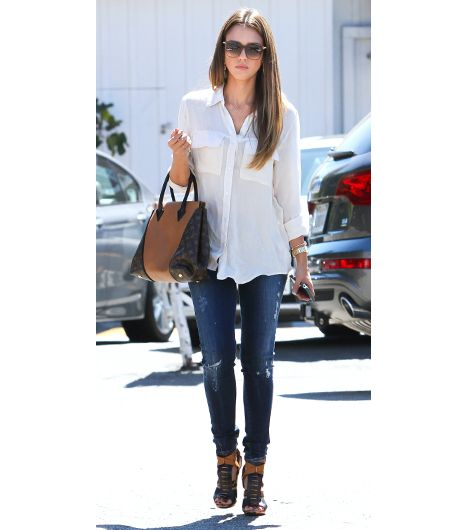 9. Collared Button-Down   You can't go wrong with a classic button-down shirt. Wear it tucked in if you want to highlight your waist, or if you'd rather draw attention away from your...