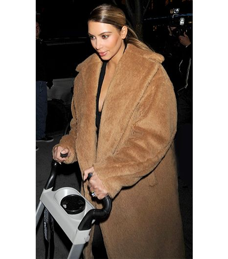 She may be a California girl but Kim Kardashian certainly knows how to handle the chill of a New York winter, with this MaxMara Carrara coat. 