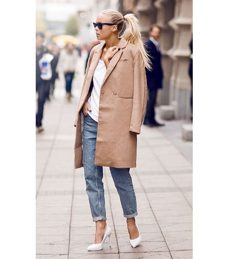 Blogger Victoria Tornegren of I'm Next does the classic cape-as-coat with one from H&M, draped over a slouchy t-shirt and Topshop Moto Vintage Mom Jeans ($65)...