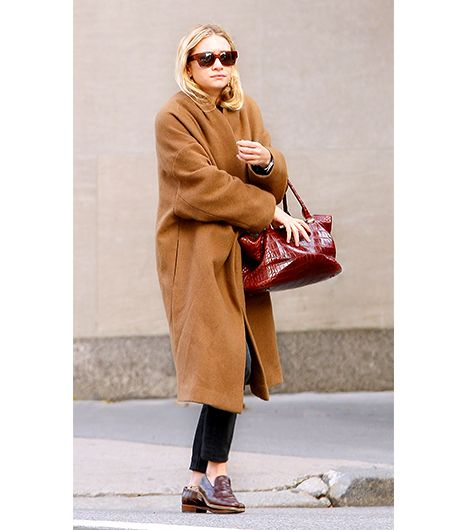 Another styling lesson courtesy of Ashley Olsen: Offset a rich caramel-hued version like this with structured, jewel-toned accessories.
