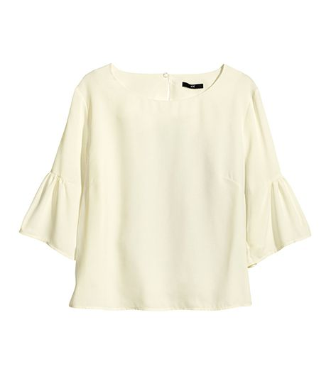 The affordable price of this blouse makes trying the look less of a commitment.  H&M Ruffle Blouse ($30)