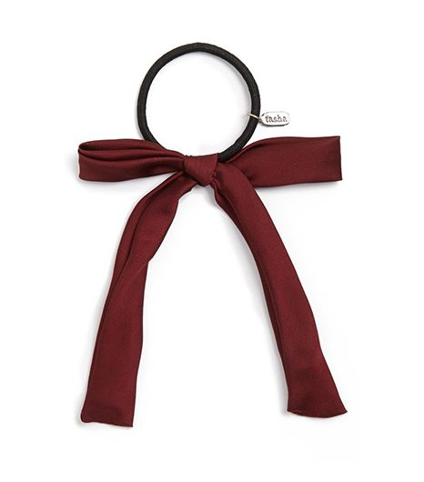 Does locating the perfect ribbon feel like a hassle? Never fear, these pre-made bow ponytail holders will do the trick.  Tasha Bow Peep Ponytail Holder ($14) in Burgundy